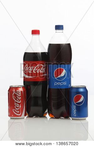 Kuala Lumpur,Malaysia -15 July 2016  Coca-Cola and Pepsi cans on white background. Symbolic representation of one of the greatest business rivalries of all time.