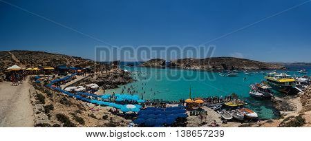June 2016: Blue Lagoon Bay: Gozo, Malta: a popular tourist destination on sunny days