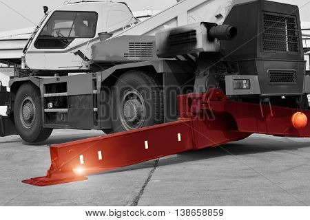 crane truck outrigger stabilizing legs extended. pump truck outrigger Heavy duty steel crane outrigger pad in construction site .