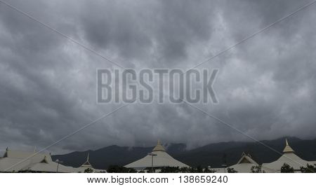 cloudscape and asian building in rainy day