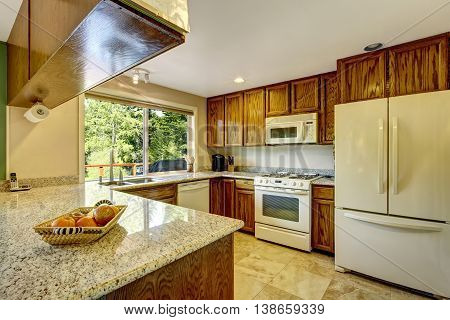 View Of Kitchen Room With Hardwood Cabinets And Tile Flooring