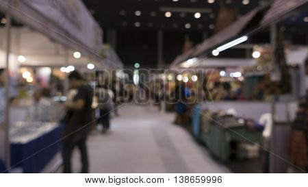 People Shopping In Exhibiton Trade Fair - Blur