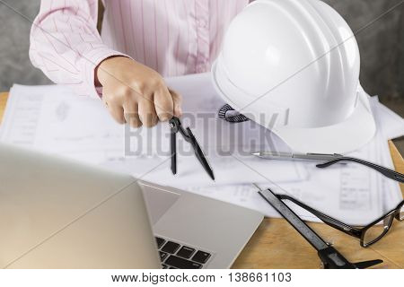 Architect Hand Holding Compass Working On Construction Engineering Project