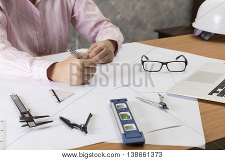 Architect Working On Construction Project