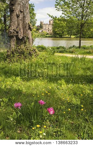 Landscape Image Of Old Victorian House Viewed Across Lake On Summer Day.