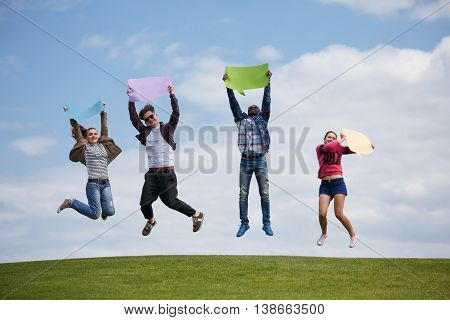 Men and women enjoying summer weather and shining sun. Best friends having rest outdoors. People spending free time on picnic.