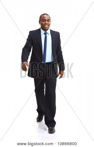 Full length of a confident young African American business man standing on white