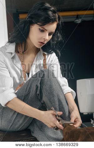 Girl Sews Clothes.