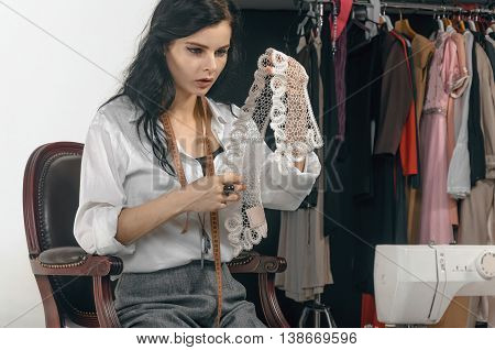 Fashion Designer Selects The Items Of Clothing.