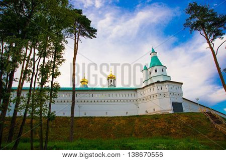Novospassky Monastery. New Monastery Of The Saviour. Fortress Wall Against The Evening Sky. Russia.