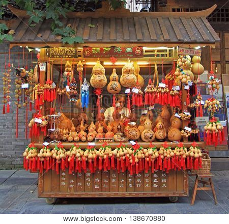 Chengdu China - June 17 2015: woman is selling typical chinese souvenirs outdoor in Chengdu China