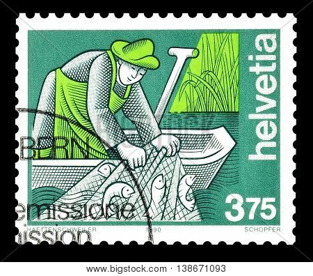 SWITZERLAND - CIRCA 1990 : Cancelled postage stamp printed by Switzerland, that shows fisherman.
