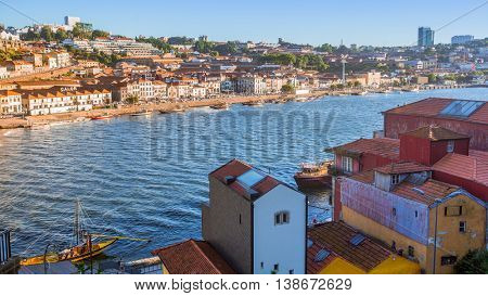 PORTO, PORTUGAL - JUL 9, 2016: View of Douro river and coasts of Ribeira and of Vila Nova de Gaia. City of Porto won the European Best Destination 2012 and 2014 awards.
