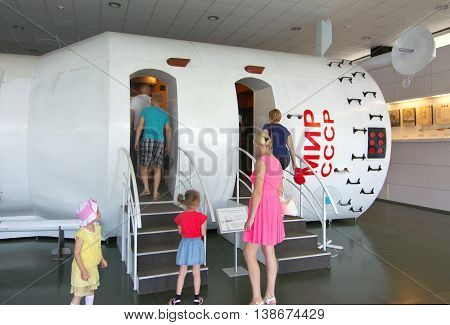 Kaluga, Russia - July 13, 2014, Tourists viewing the base unit orbital station