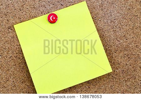 Blank Yellow Paper Note Pinned With Turkey Flag Thumbtack