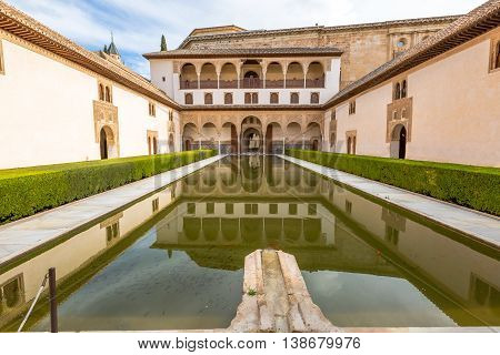 The Patio de los Arrayanes or courtyard of the Myrtles within the popular Palacios Nazaries, one of the most visited attractions of Alhambra de Granada Unesco Heritage in Andalusia, Spain.