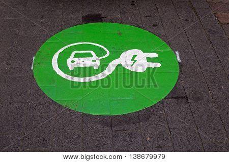 Sign for charging station for electric cars on asphalt