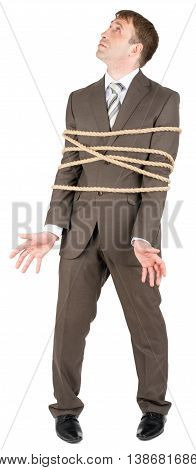 Businessman with briefcase and tied with rope screaming