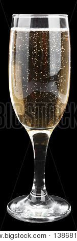 Champagne glass on black background, close up view