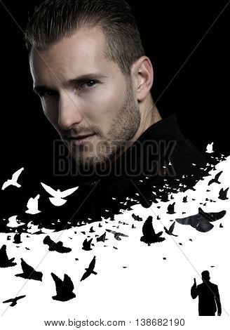 Handsome mysterious man posing over a black background