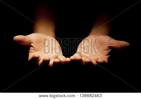A praying hands with a black background