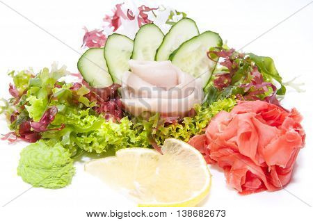 Japanese cuisine sashimi with vegetables and fish in a restaurant