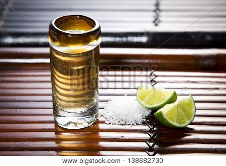 A tequila shot with salt and lime