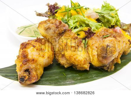 chicken in curry with salad and sauce on a white background