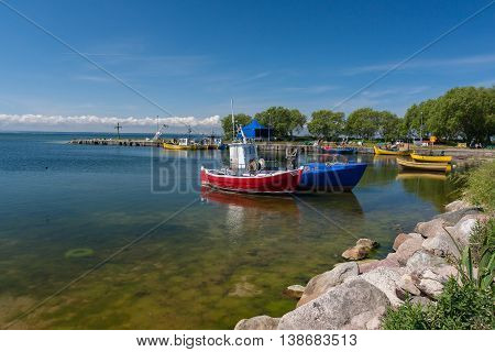 Fishing boats in the harbor in the sun