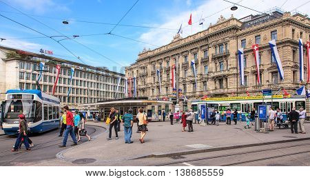 Zurich, Switzerland - 1 August, 2014: view on Paradeplatz square from Bahnhofstrasse street. Zurich is the largest city in Switzerland and the capital of the Swiss canton of Zurich.