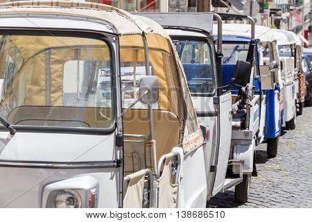 tuk-tuk - small transport for tourists on european street