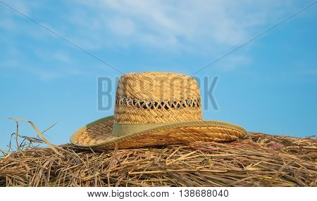 cowboy hat lying on haystack against the sky