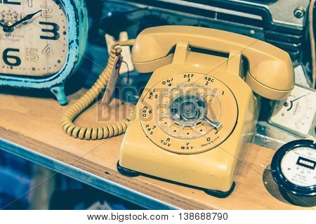Yellow Vintage Rotary Phone With Toned Effect