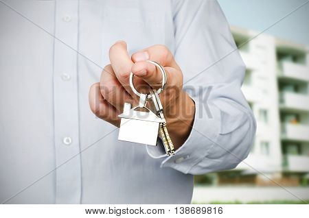 Estate Agent Holding Keys To New House