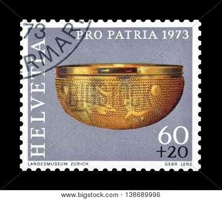 SWITZERLAND - CIRCA 1973 : Cancelled postage stamp printed by Switzerland, that shows Golden bowl.