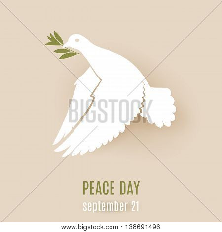 Design for Peace day with flying white dove with green twig in its beak
