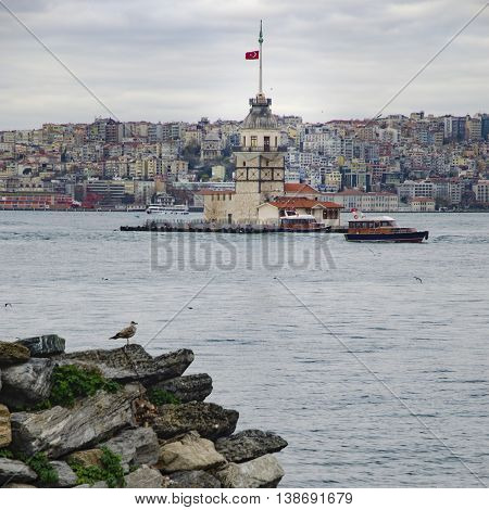 The Maiden's Tower (Turkish: Kiz Kulesi) also known as Leander's Tower since the medieval Byzantine period is a tower lying on a small islet located at the southern entrance of the Bosphorus strait 200 m from the coast of Uskudar in Istanbul Turkey.