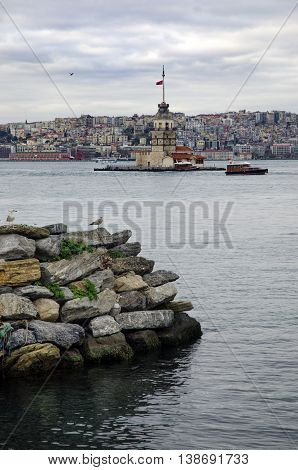 The Maiden's Tower (Turkish: Kız Kulesi) also known as Leander's Tower since the medieval Byzantine period is a tower lying on a small islet located at the southern entrance of the Bosphorus strait 200 m from the coast of Üsküdar in Istanbul Turkey.