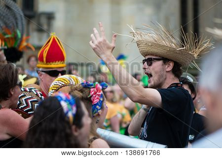BATH SOMERSET UK - JULY 16 2016 Man conducting drummers in straw hat. Bath Carnival procession bringing a South American festival atmosphere to Somerset