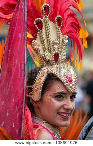 BATH SOMERSET UK - JULY 16 2016 Head and feathers of dancer. Bath Carnival procession around the streets of the city of Bath bringing a South American festival atmosphere to Somerset