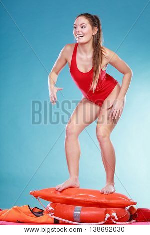 Happy Lifeguard Woman On Rescue Ring Buoy.