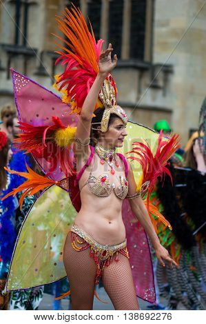 BATH SOMERSET UK - JULY 16 2016 Bikini dancer with feathers. Bath Carnival procession around the streets of the city of Bath bringing a South American festival atmosphere to Somerset