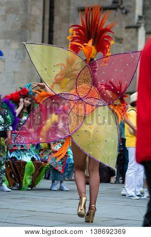 BATH SOMERSET UK - JULY 16 2016 Carnival dancer in thong with feathers. Bath Carnival procession around the streets, bringing a South American festival atmosphere to Somerset