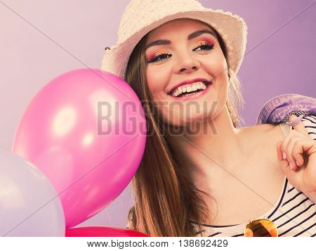 Girl dancing with balloons. Young female partying cheering. Celebration entertainment happines party concept.