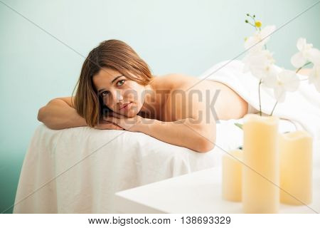 Pretty Young Woman Laying On A Massage Bed