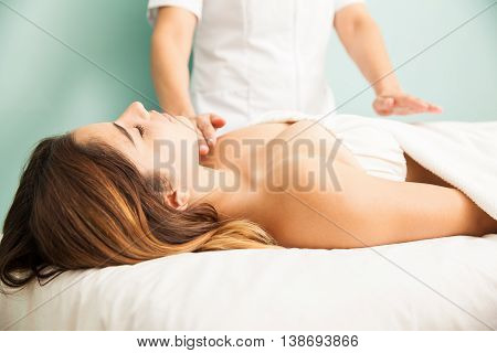 Woman In The Middle Of A Reiki Therapy Session