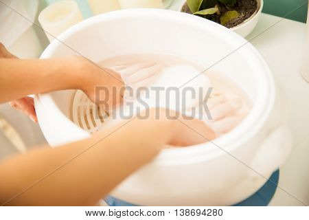 Woman Getting Wax In Her Hands At A Spa