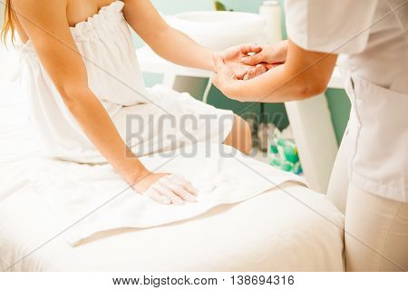 Therapist Removing Wax From Client's Hands
