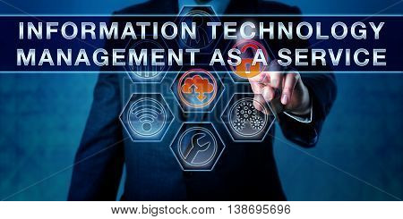 Corporate manager is pushing INFORMATION TECHNOLOGY MANAGEMENT AS A SERVICE on an interactive touch screen interface. Business metaphor and managed services concept.