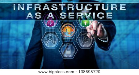 Manager touching INFRASTRUCTURE AS A SERVICE on an interactive control monitor. Information technology metaphor. Cloud computing and cloud infrastructure concept. Close up torso shot of man in suit.